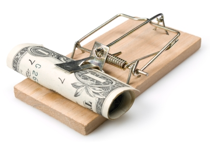 Mousetrap with money on white. This file is cleaned, retouched, contains clipping path and is ready to use.